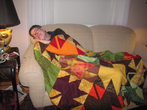My brother, Mark, sleeping happily under his new quilt.