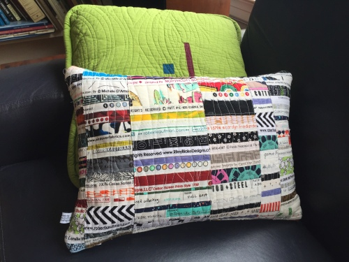New covers for the living room pillows - using up those selvage scraps!